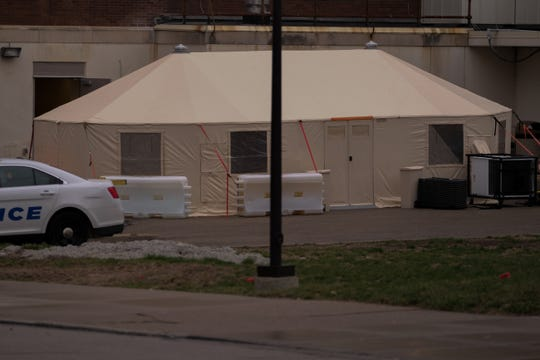 A COVID-19-related respiratory waiting area tent at the University of Cincinnati Medical Center, Saturday, March 14, 2020.