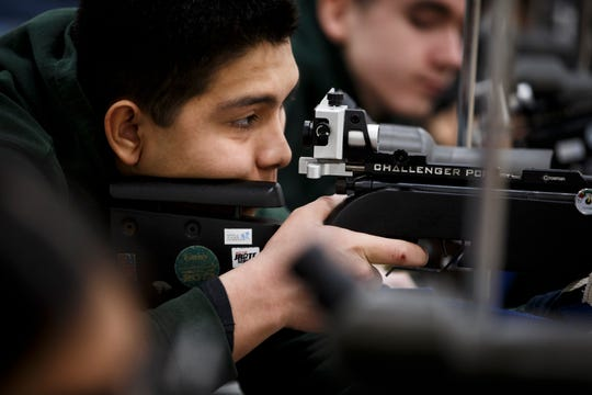 Des Moines North senior Arturo Zaragoza lines up a shot during the American Legion of Iowa Junior Shooting Sports  Championship at Camp Dodge on Saturday, March 14, 2020, in Johnston. Zaragoza would go on to finish second in his group.