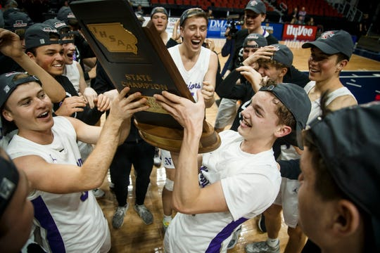 Norwalk gets their trophy after beating Sergeant Bluff-Luton 70-68 during their 3A state boys basketball championship game at Wells Fargo Arena on Friday, March 13, 2020, in Des Moines.