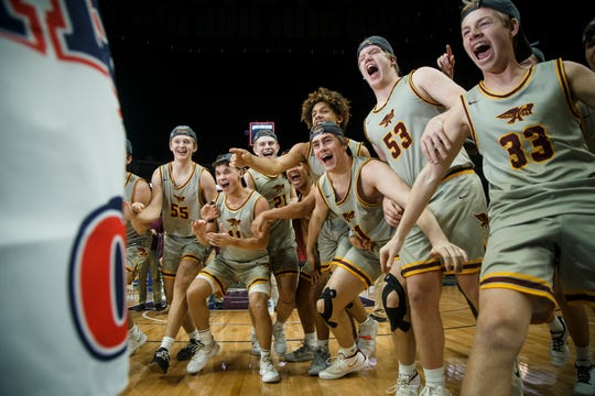 Ankeny celebrates its 78-70 win over Waukee for the 4A state boys basketball championship at Wells Fargo Arena on Friday, March 13, 2020, in Des Moines.