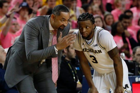 Michigan head coach Juwan Howard talks with guard Zavier Simpson (3) during the second half of an NCAA college basketball game against Wisconsin, Thursday, Feb. 27, 2020, in Ann Arbor, Mich. (AP Photo/Carlos Osorio)