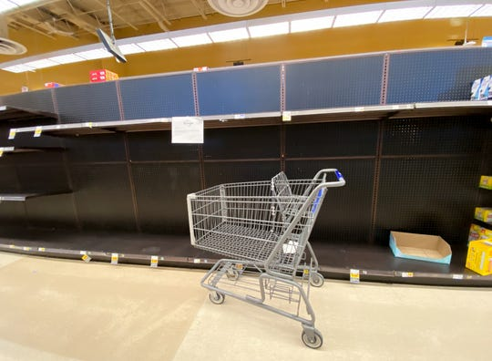 Kroger in Grosse Pointe is limiting customers to 3 each of high-demand items like bath tissue, hand sanitizer, and some medications Friday afternoon, March 13, 2020. Shoppers across Michigan are also stocking their pantries with essentials like bread, meat, eggs, and canned goods in anticipation of a coronavirus outbreak in the area.