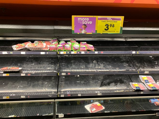 Empty shelves at the Kroger in Royal Oak Township on Sat., March 14, 2020. Shoppers across Michigan are stocking their pantries with essentials like bread, meat, eggs, and canned goods.