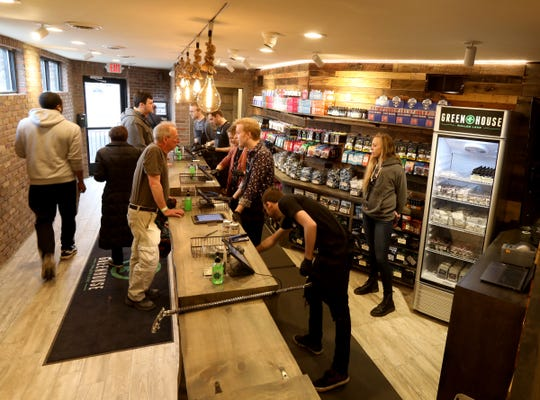 People placing orders for recreational marijuana in the back of Greenhouse which is one of the first Oakland County recreational marijuana dispensary that opened up on Saturday morning, March 14, 2020. They were letting three people in at a time to control the amount of people inside as several budtenders and cashiers helped answer questions and ring customers up.