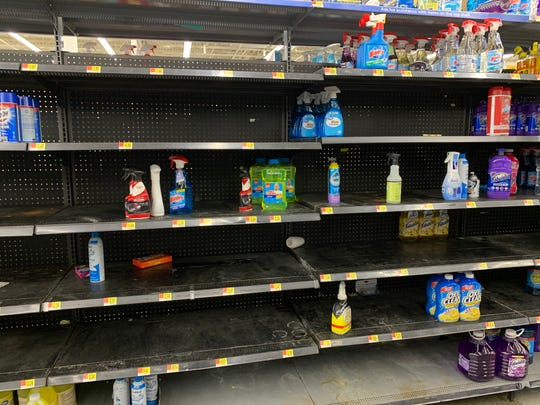 Empty shelves at a Walmart in Dearborn on Sat., March 14, 2020. Shoppers across Michigan are stocking their pantries with essentials like bread, meat, eggs, and canned goods in anticipation of a coronavirus outbreak in the area.