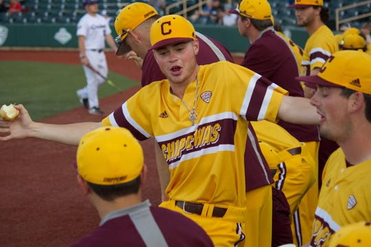 Central Michigan pitcher Cameron Brown talks with teammates during the MAC tournament on May 25, 2019, in Avon, Ohio.