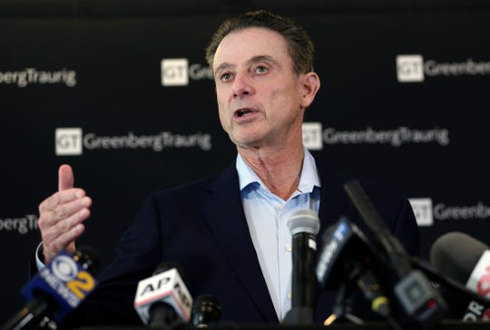 Former Louisville coach Rick Pitino replaces Tim Cluess, who resigned Friday after 10 years and six NCAA Tournament appearances due to health concerns.
