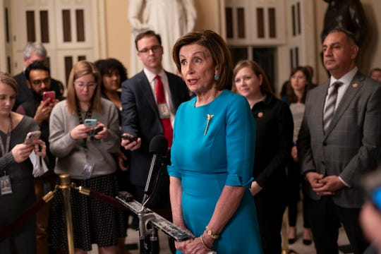 Speaker of the House Nancy Pelosi, D-Calif., makes a statement ahead of a planned late-night vote on the coronavirus aid package deal the Trump administration, at the Capitol in Washington, Friday.