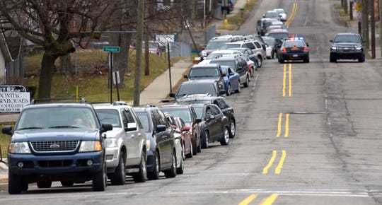 Traffic is backed up on E. Pike Street before the food is distributed.