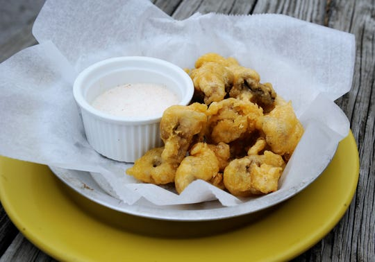 Hand-battered fried mushrooms with spicy house horseradish sauce at Bob's Lounge.