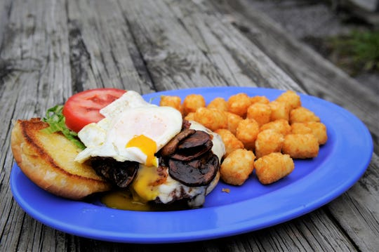 A burger with sauteed red wine mushrooms, bacon jam, provolone cheese and a fried egg  at Bob's Lounge.