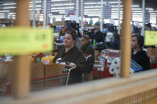 Many grocery stores are hiring additional employees to meet customer demand and re-stock and clean stores as traffic surges.