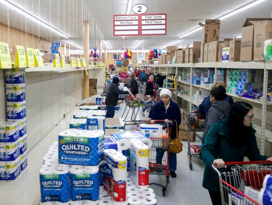 Shoppers quickly emptied shelves of toilet paper and other household items up on household items the day after President Donald Trump announced a national state of emergency due to the spread of the new coronavirus and its economic fallout. Stores have struggled to keep items in stock since then