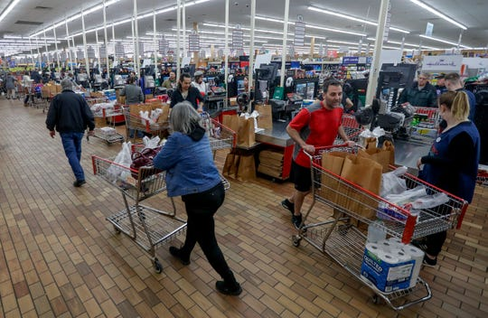 Customers packed Woodman's Markets' store in Howard on Saturday, quickly emptying shelves of toilet paper and other household items, after President Donald Trump announced a national state of emergency due to the spread of the new coronavirus and its economic fallout. Stores have struggled to keep items in stock since then.