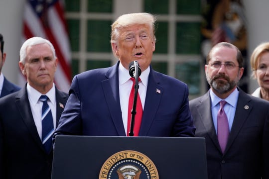 President Donald Trump speaks during a news conference Friday about the coronavirus in the Rose Garden of the White House.