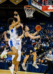 Great Falls High's Levi Torgerson goes up for a layup as Billings Skyview's Julius Mims defends in the semifinal round of the Class AA State Basketball Tournament in Bozeman on Friday.