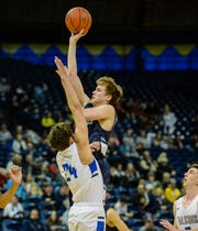 Great Falls High's Drew Wyman attempts a shot over Billings Skyview's Ky Kouba in the semifinal round of the Class AA State Basketball Tournament in Bozeman on Friday.