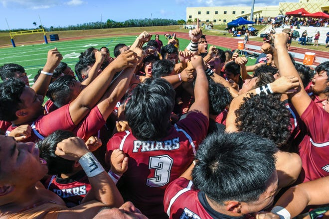 Father Duenas Friars rugby team members celebrate after winning the Boys' GFRU/ISA Rubgy League championship at the Guam High School field in Agana Heights on Saturday, March 14, 2020. The Friars were victorious in the game that played into sudden death against the Simon Sanchez Sharks, with a score of 20-5.