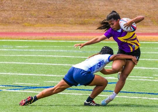 The Notre Dame Royals and George Washington Geckos face off during the Girls' GFRU/ISA Rubgy League championship game at the Guam High School field in Agana Heights March 14. Guam's high school sports organizations are taking steps to prepare for coronavirus health and safety impact.