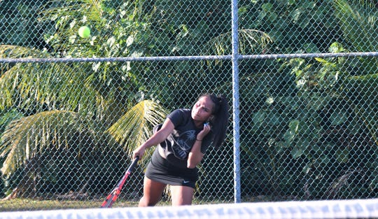St. John's top singles player, No. 2 seeded Kaia Malakooti, serves against top seeded Joycelyn Tenai of Academy of Our Lady of Guam on March 13 at the Ninete Tennis Center in Hagåtña. Malakooti upset Tenai 8-3 to claim the girls single title in the high school Islandwide Tennis Tournament.