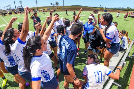 Notre Dame Royals' Seniayeth Bell, right, leads her fellow teammates in a cheer after winning the Girls' GFRU/ISA Rubgy League championship at the Guam High School field in Agana Heights on Saturday, March 14, 2020. The Royals were victorious in the final game of the season against the George Washington Geckos.