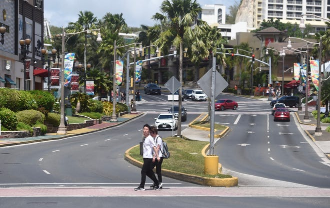 Tourists walk the streets of Tumon in the midst of the COVID-19 pandemic on March 13, 2020. March 1-9 had 29% fewer visitors from Japan and 79.2% fewer visitors from South Korea, the island's two primary markets.