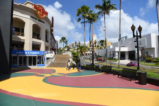 Tourists walk the near-empty streets of Tumon in the midst of the COVID-19 pandemic in this March 13 file photo.
