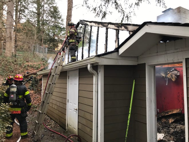 Firefighters battle a blaze at a home on Valencia Road in Sequoyah Hills, March 14, 2020.