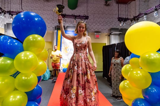 Sara Bruce models her prom dress at The Butterfly Effect prom dress giveaway on Saturday, March 14, 2020.