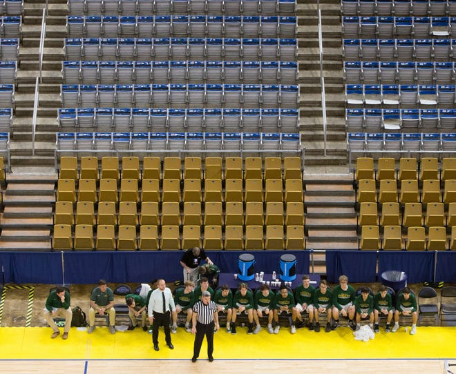 Pleasant Hill and Hicks High School play the boys' state championship Class C game in a largely empty Burton Coliseum in Lake Charles, La., Friday, March 13, 2020. Fans were banned from the arena after Gov. John Bel Edwards prohibited large gatherings in response to the coronavirus. (Rick Hickman/American Press via AP)