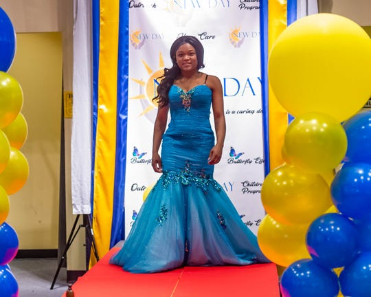 Markayla Williams shows off her chosen prom dress at the Butterfly Effect Prom Dress Giveaway on Saturday, March 14, 2020.