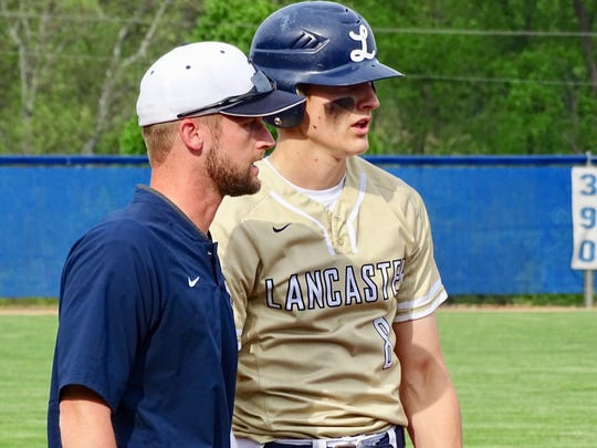 """Lancaster coach Corey Conn gives instructions to Evan Sines during a game last season. The spring sports season has been put on hold after The Ohio High School Athletic Association as issued a """"no contact"""" period until April 6, meaning teams cannot practice or use their school facilities at all during the next three weeks."""