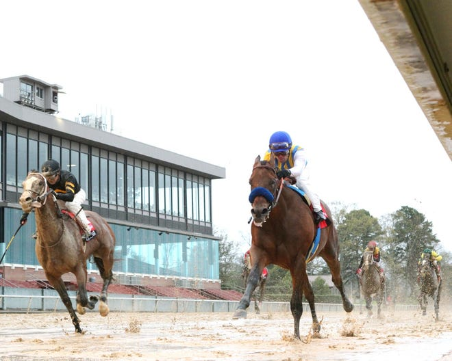 Nadal, right, holds off Excession to win the $1 million, Grade 2 Rebel Stakes on March 14 at Oaklawn Park in Hot Springs, Arkansas.