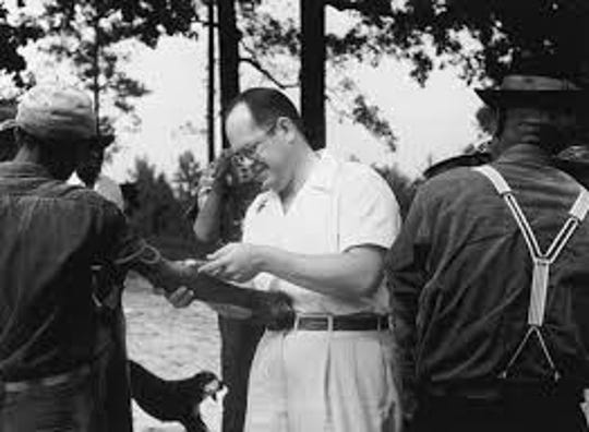 A doctor examines a patient as part of the Tuskegee Syphilis Study.