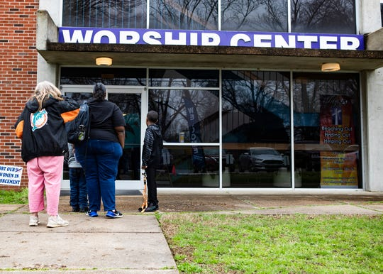 Memphis residents form a line outside of  Impact Baptist Church in Memphis,Tenn., during the food pantry drive  on Saturday, March 14, 2020.