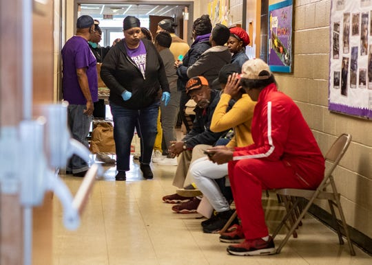 Memphis residents fill the hallway at Impact Baptist Church in Memphis,Tenn., on Saturday, March 14, 2020.