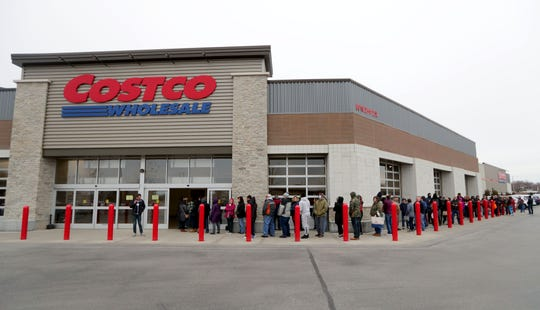 Hundreds of people line up waiting for doors to open at Costco in Menomonee Falls on Saturday. The store was limiting customers to one 30-pack case of toilet paper.