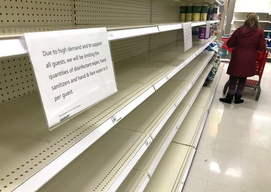 A sign explains quantity restrictions to customers at Target in Menomonee Falls on Saturday.