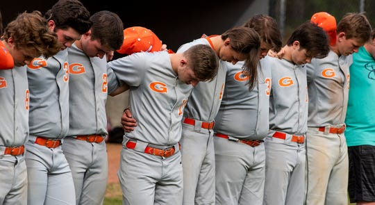 Glenwood players pray before the game on the Autauga Academy campus in Prattville, Ala., on Friday March 13, 2020.