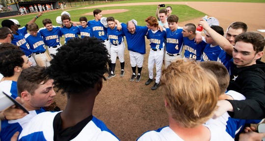 Autauga Academy players gather around their coach Scott Tubbs before the Glenwood game on the Autauga Academy campus in Prattville, Ala., on Friday March 13, 2020.
