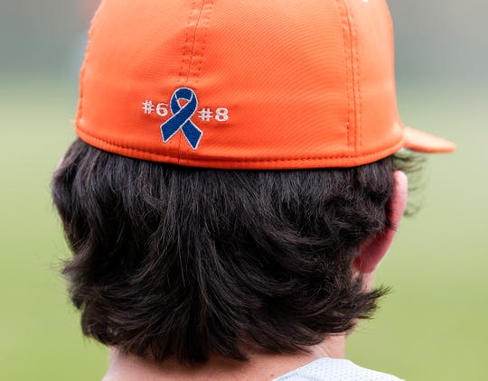 The emblem on the back of the Glenwood ball cap honors the cancer battle of their coach and the coach of their opponent Autauga Academy on the Autauga Academy campus in Prattville, Ala., on Friday March 13, 2020.