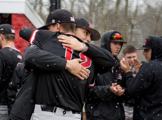 Muskingum University senior, Bryce Husted, is hugged by teammates on senior day. Denison University hosted the Muskies Saturday for the last game before the season was postponed due to COVID-19.