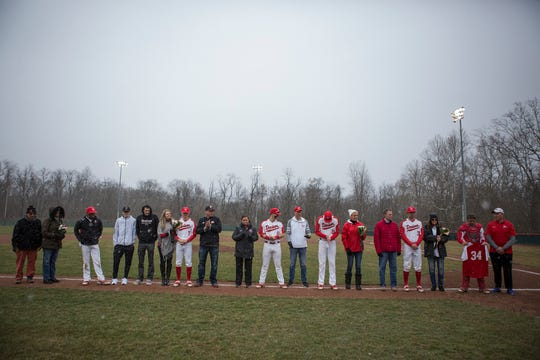 Denison University seniors and their parents pose for a portrait ahead of their game Saturday. The Big Red  hosted Muskingum University for the last game before the season was postponed due to COVID-19.