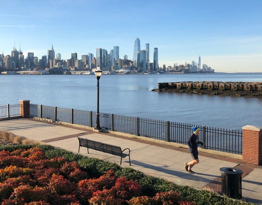 A lone jogger on an almost deserted Hudson River Walkway in West New York, NJ, on Saturday morning, March 14 amid the coronavirus crisis.