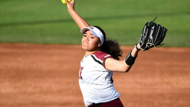 New Mexico State's Matalasi Faapito (21) throws a warm up pitch during an NCAA softball game against Wright State on Friday, March 6, 2020, in Tempe, Ariz. (AP Photo/Jennifer Stewart)