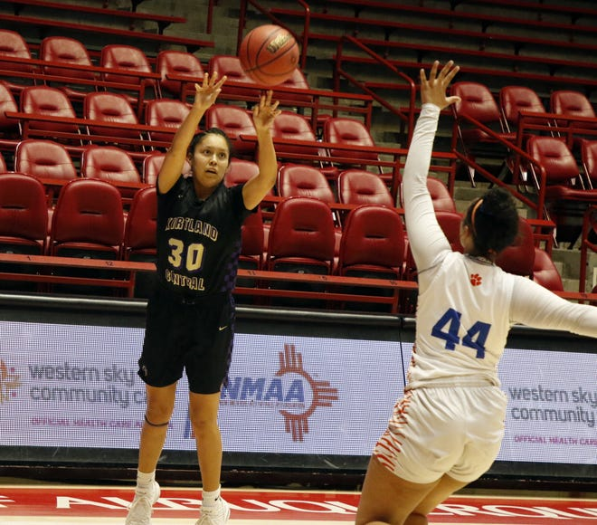 Kirtland Central's Jaymie Smart fires a 3-pointer against Los Lunas' Feleena Candelaria during the 4A girls basketball state championship on Friday, March, 13, 2020 at Dreamstyle Arena in Albuquerque. Los Lunas won, 47-33.