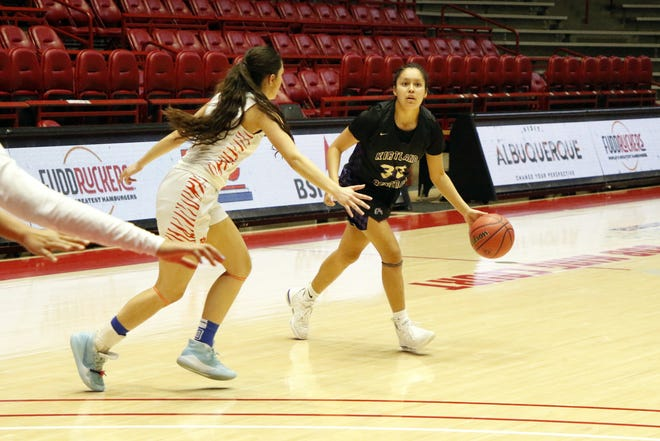 Kirtland Central's Jaymie Smart looks to pass the ball against Los Lunas during the 4A girls basketball state championship game on Friday, March 13, 2020 at Dreamstyle Arena in Albuquerque. Los Lunas won, 47-33.