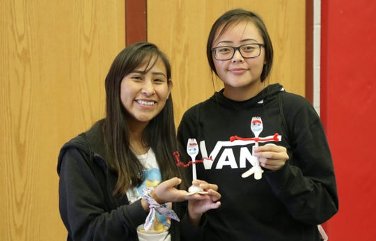 """Red Valley-Cove High School students Timieka Curley, left, and Tiffany Begay made versions of Forky, a """"Toy Story 4"""" character, at the Diné Maker Nation Faire on March 12 at Navajo Technical University in Crownpoint."""