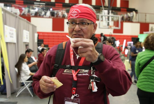 Tohatchi High School teacher Albert Jim Jr. samples some chili at the chili competition at the Diné Maker Nation Faire on March 12 at Navajo Technical University in Crownpoint.