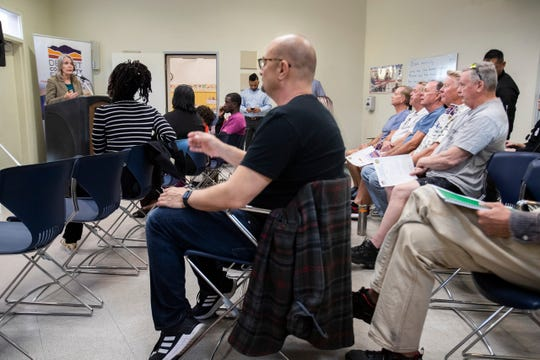 Members of the community listen to Katie Barrows, director of environmental resources at the Coachella Valley Association of Governments, speak at the James O. Jesse Highland Unity Center in Palm Springs.